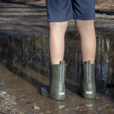 Cirrus™ Kid's Charley Tall Rain Boot in Loden on Model in a Puddle
