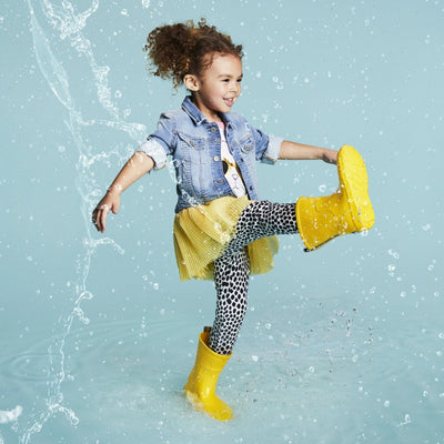 Cirrus™ Kid's Charley Tall Rain Boot in School Bus On Model in the Rain
