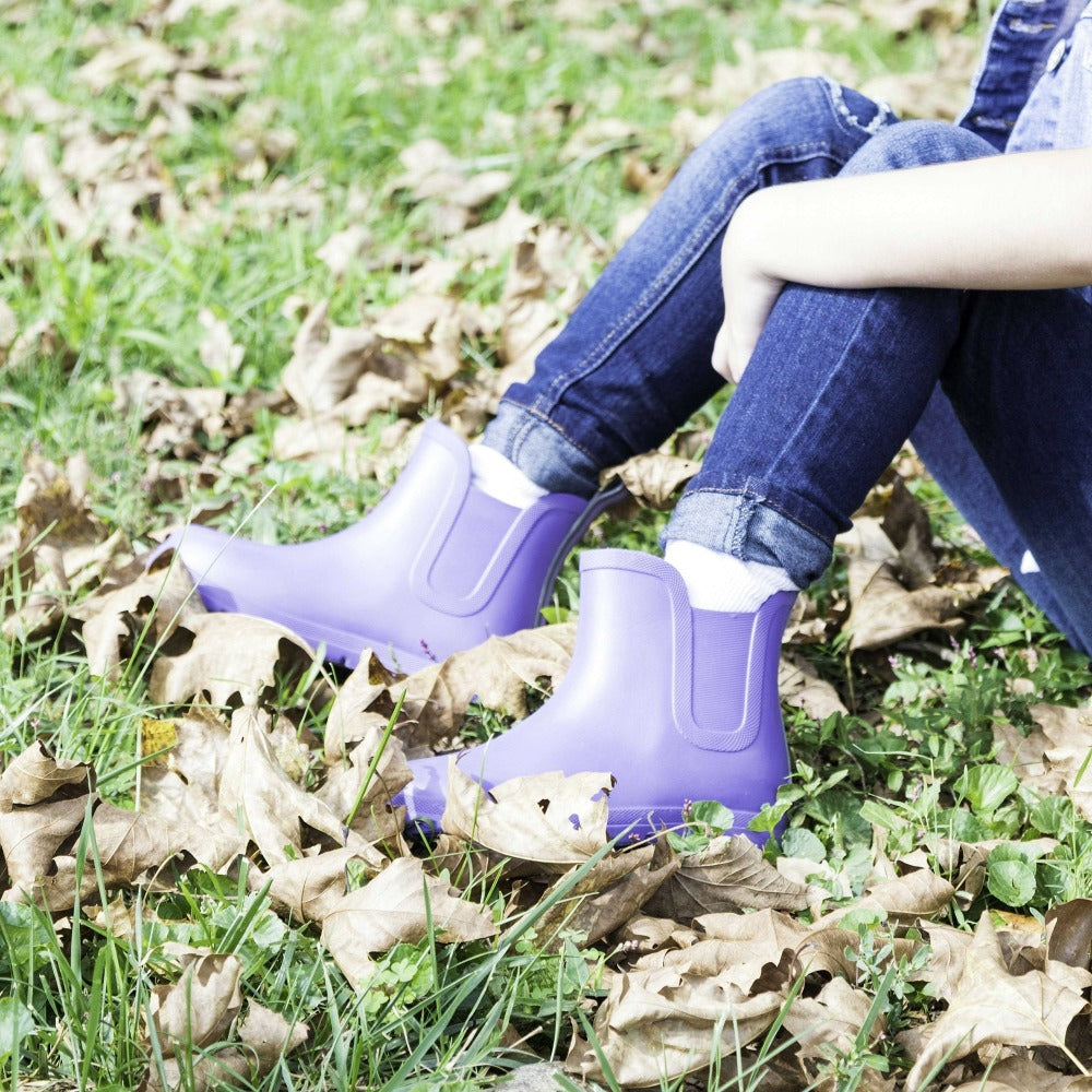 Cirrus™ Kid's Chelsea Ankle Rain Boot in Paisley Purple On Model in Fall Leaves