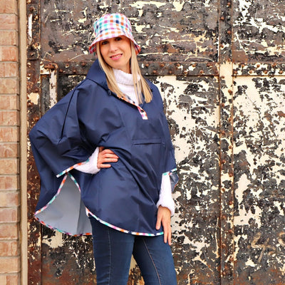 Reversible Rain Poncho in Rainbow Gingham On Model with Bucket Hat