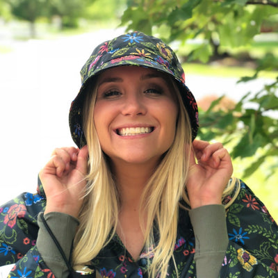 Bucket Rain Hat in Embroidered Floral On Model with Matching Poncho