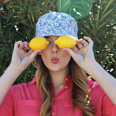 Bucket Rain Hat in Country Lace On Model with Lemons