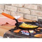 "Seasoned Carbon Steel Skillet with Silicone Handle Holder 10"" by Lodge"