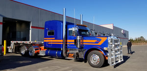 Peterbilt Mid-Triple Stripe Purple Truck Coming Out of Garage - TruckStripes.ca