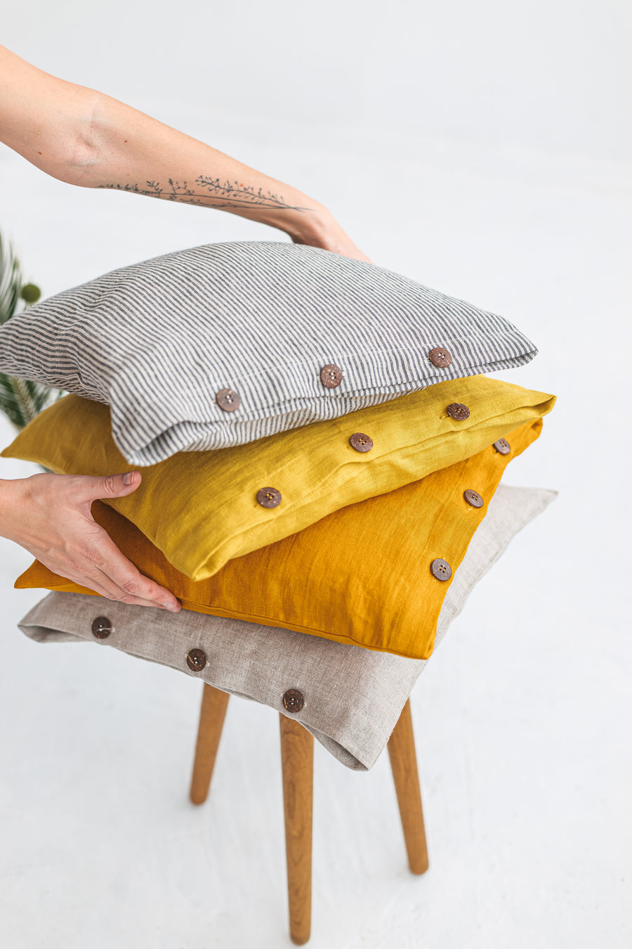 yellow linen pillow cover with buttons