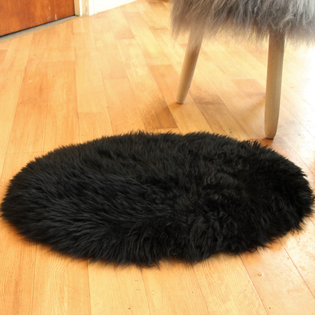 Black Oval Sheepskin Rug