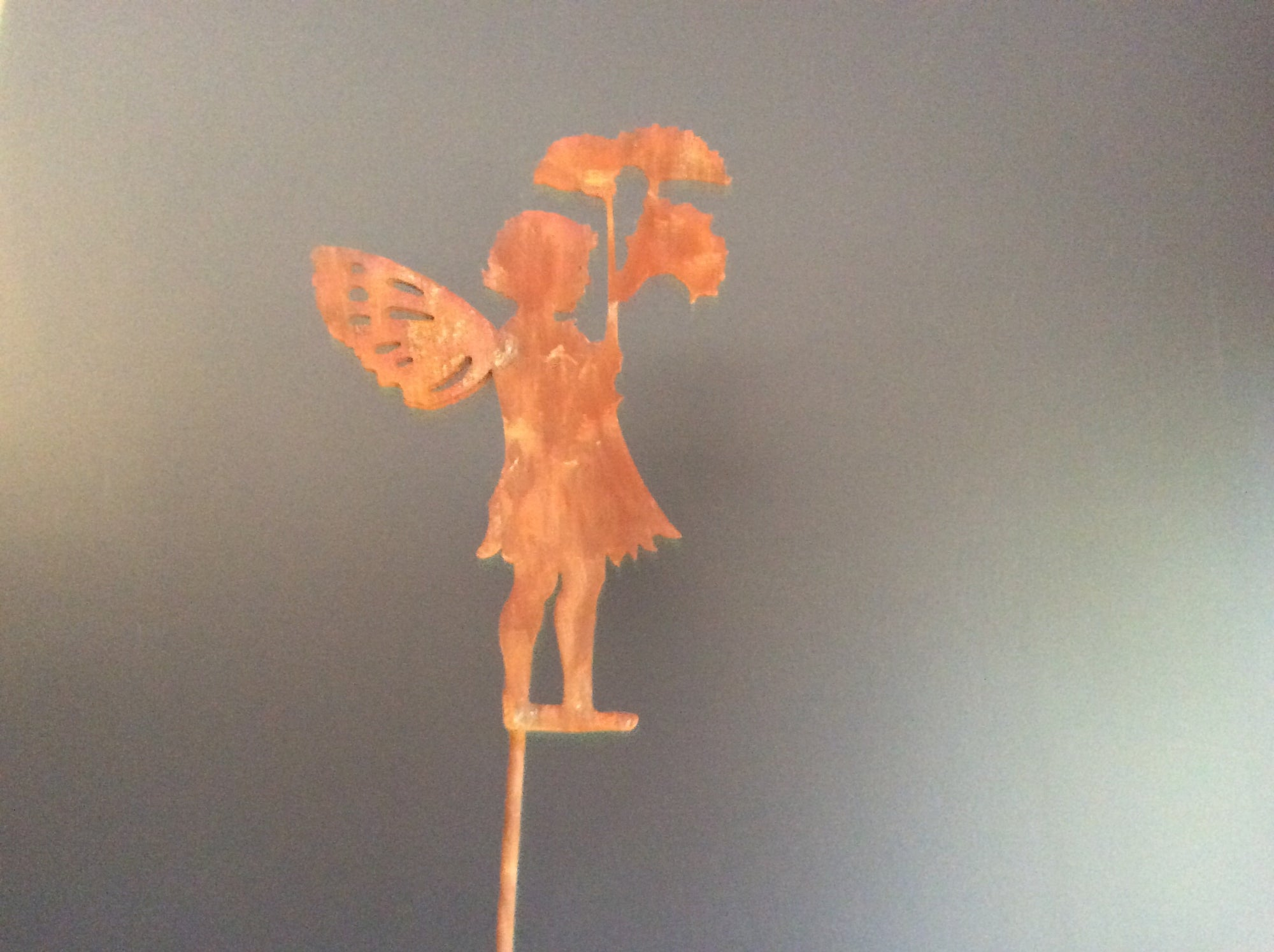 Rust Double winged Angel with flowers/leaves