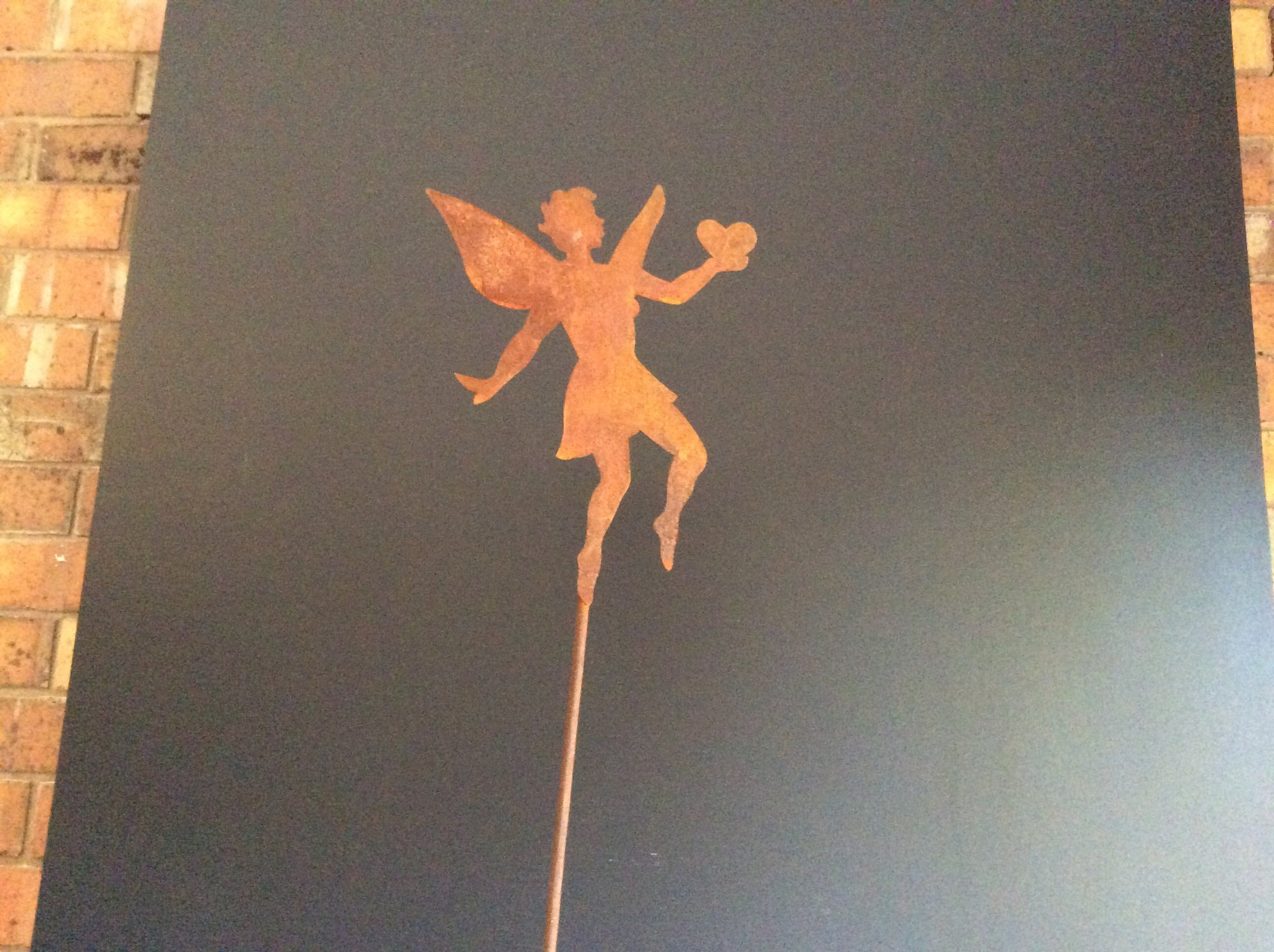 Rust Angel with Heart Stake