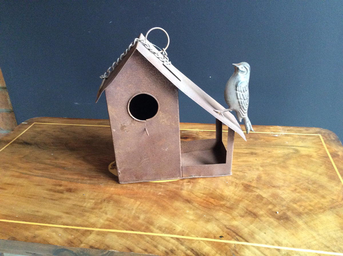 Rust Hanging Birdhouse with bird on sloping roof