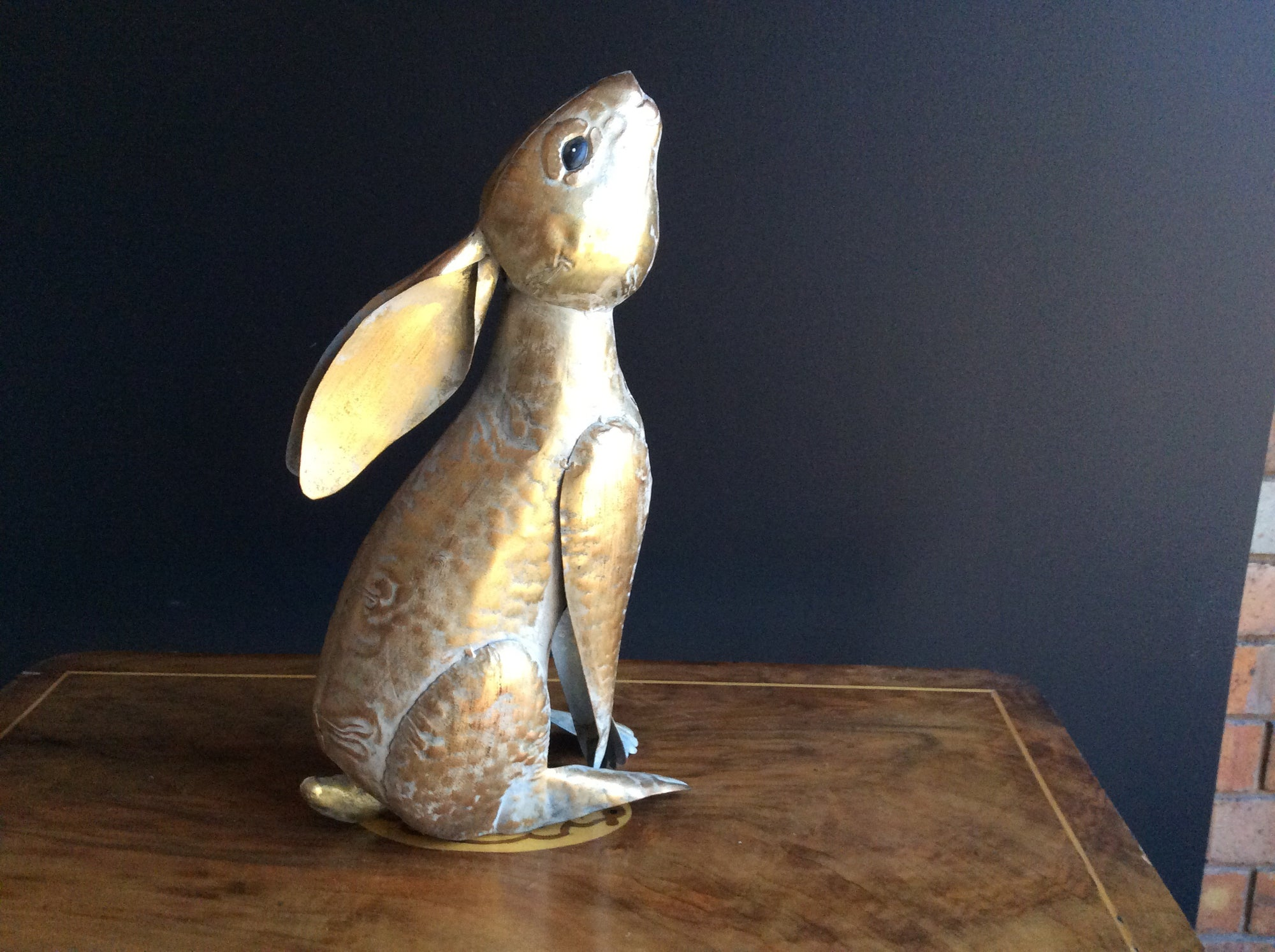 Gold Metal Rabbit looking up