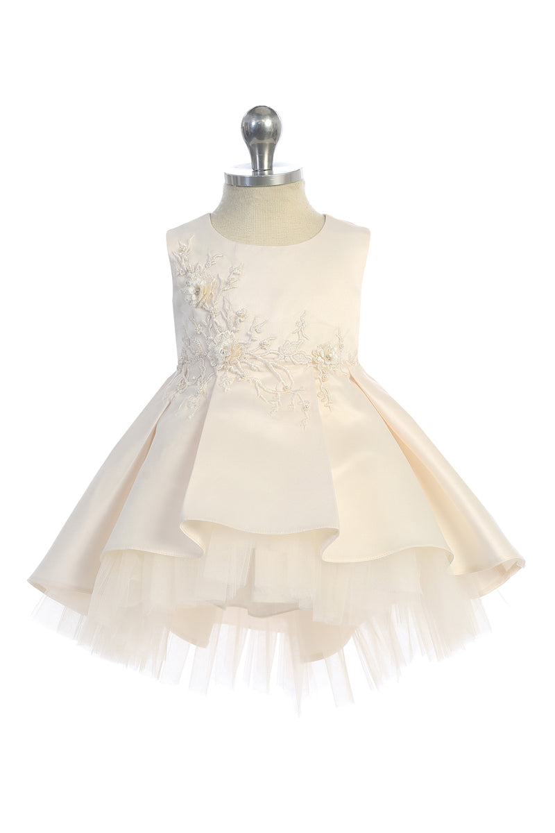 champagne baby girl party dress with floral lace applique bodice and tulle high low bottom available at carmens designs toronto
