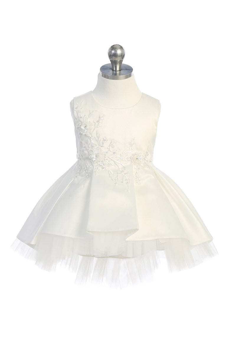 ivory baptism dress with floral lace applique bodice and tulle high low bottom available at carmens designs toronto