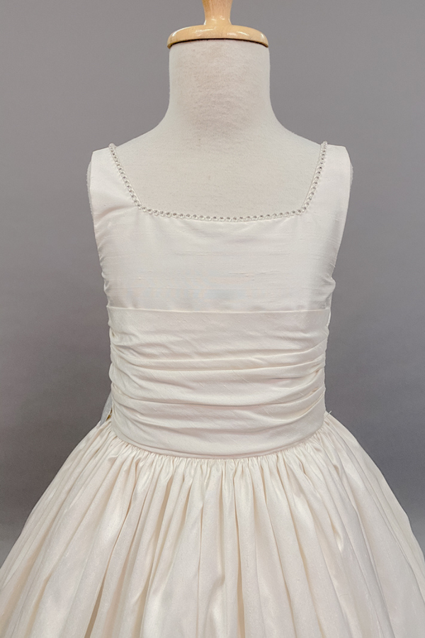 carmens designs custom made communion dress with ruffled waist band and sparkled beads neckline