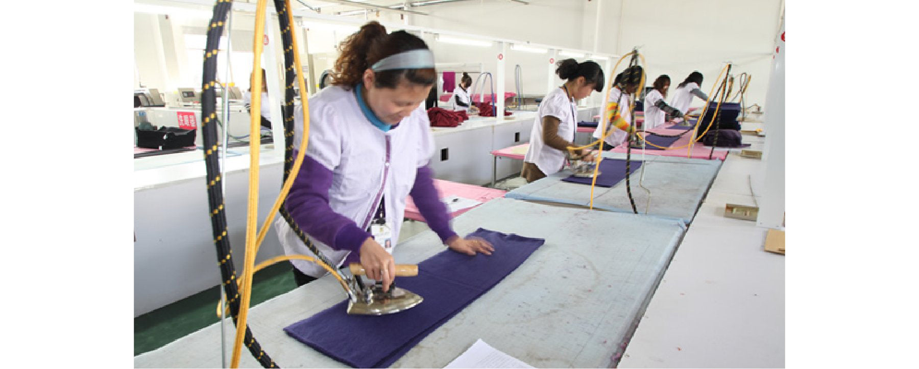 Women working at Les Cent Ciels fashion factory