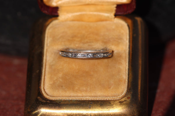 18k white gold baguette and round half eternity band size 6.5 (sizable 1 size either way)