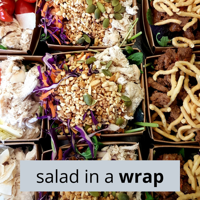 Chicken Satay Salad in a Wrap. Oven-roasted free-range chicken, peanuts, shredded carrot, shredded red cabbage, and mesclun topped with a house-made peanut dressing.