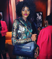 Claudette Clutch with interior light on beautiful model/actress Aube Jolicoeur starring in #afrimericans.
