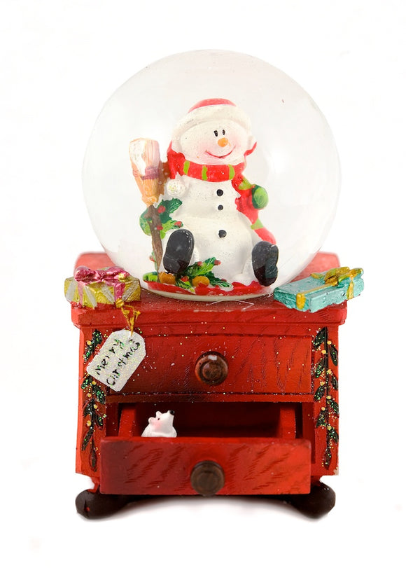 Santa Snow Globe On A Chest Of Draws