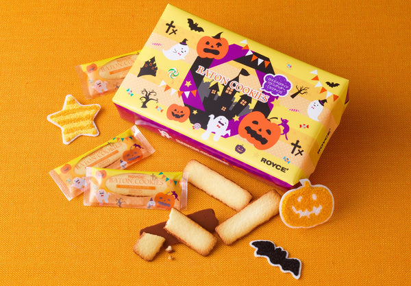 ROYCE' Halloween Baton Cookies, individually wrapped golden-baked coconut cookies coated with milk chocolate on one side. Comes with Halloween-inspired packaging with illustrations of ghosts, bats, and Jack O' Lanterns.