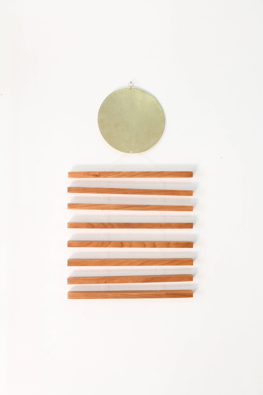 brass cherry wood wall hanging
