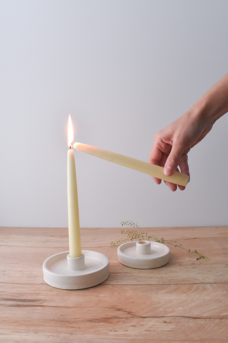 white ceramic candlestick holder
