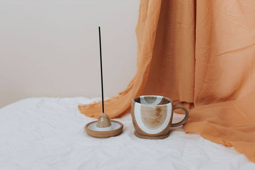 brown ceramic incense holder mug