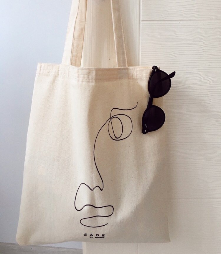 one line drawing tote bag