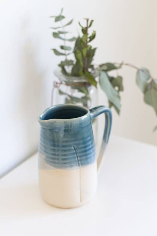 blue dipped ceramic pitcher
