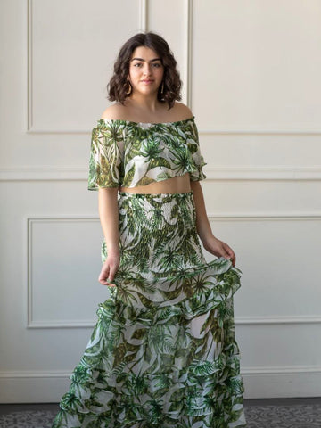 woman wearing a palm leaf two piece outfit