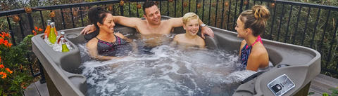 four people soaking in freeflow hot tub