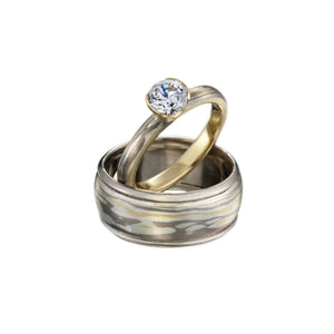 Silver/white and yellow gold Desert pattern solitaire