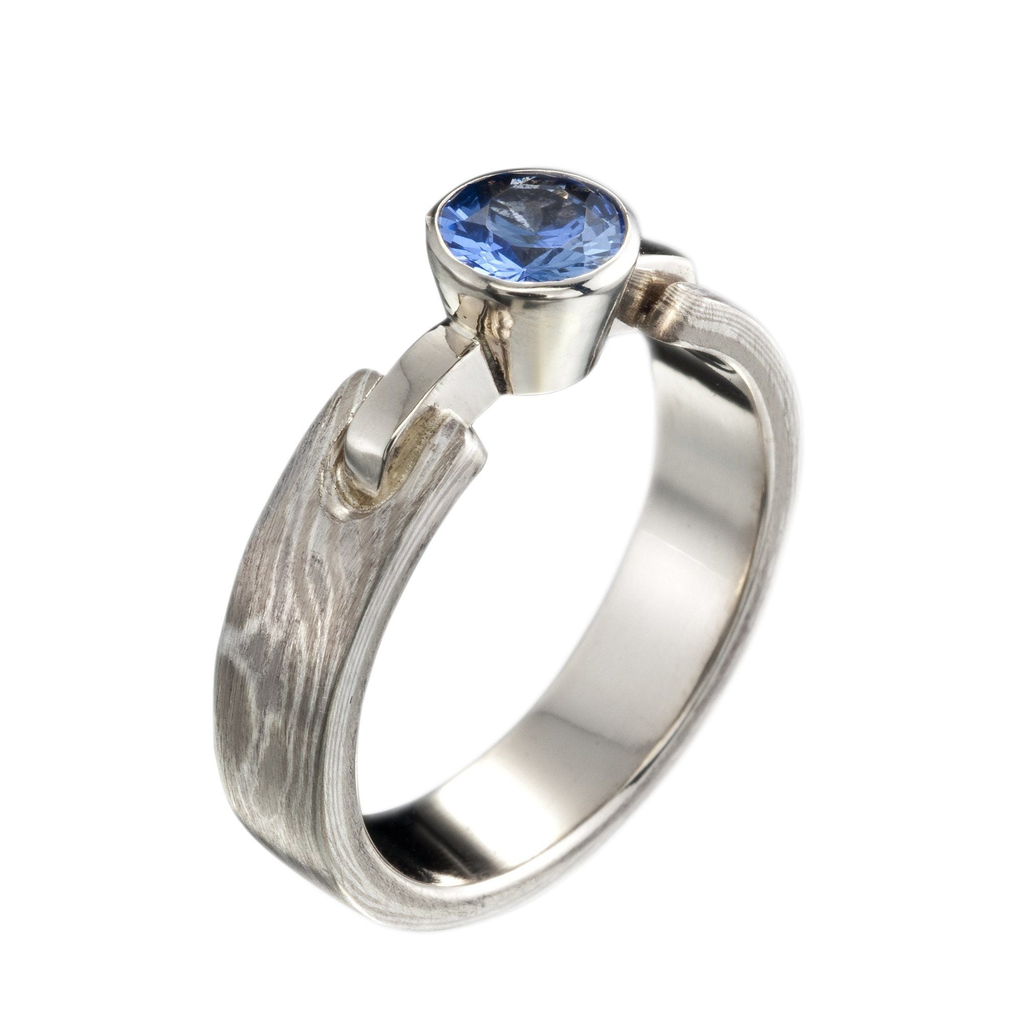 Silver/ white gold Woodgrain solitaire with sapphire