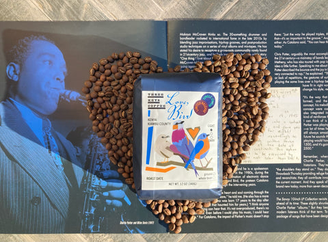 coffee beans in the shape of a heart with charlie parker and the Love Bird Kenyan coffee by Three Keys