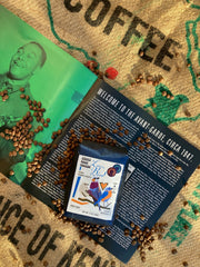 "liner notes, charlie parker, love bird kenyan coffee on top of a burlap sack of coffee. Page says ""Welcome to the Avant Garde circa 1947"""