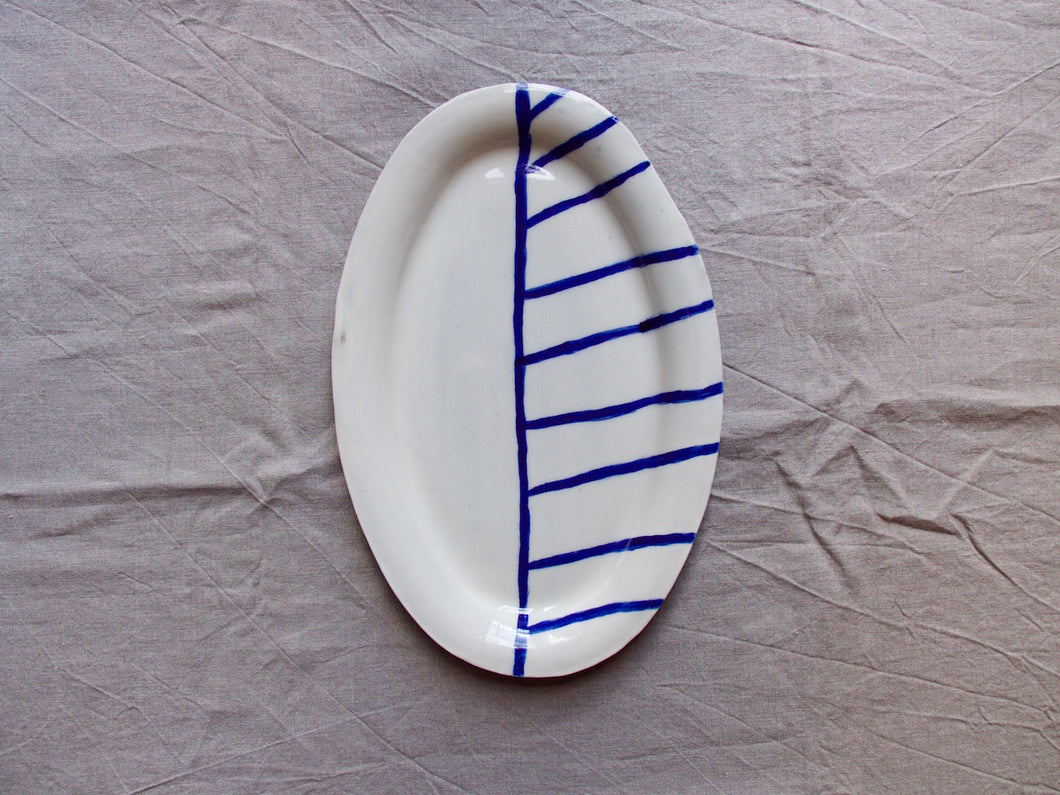 myhungryvalentine-studio-ceramics-stripes-flatovalservingdish-cream-cobaltbluestripes-top