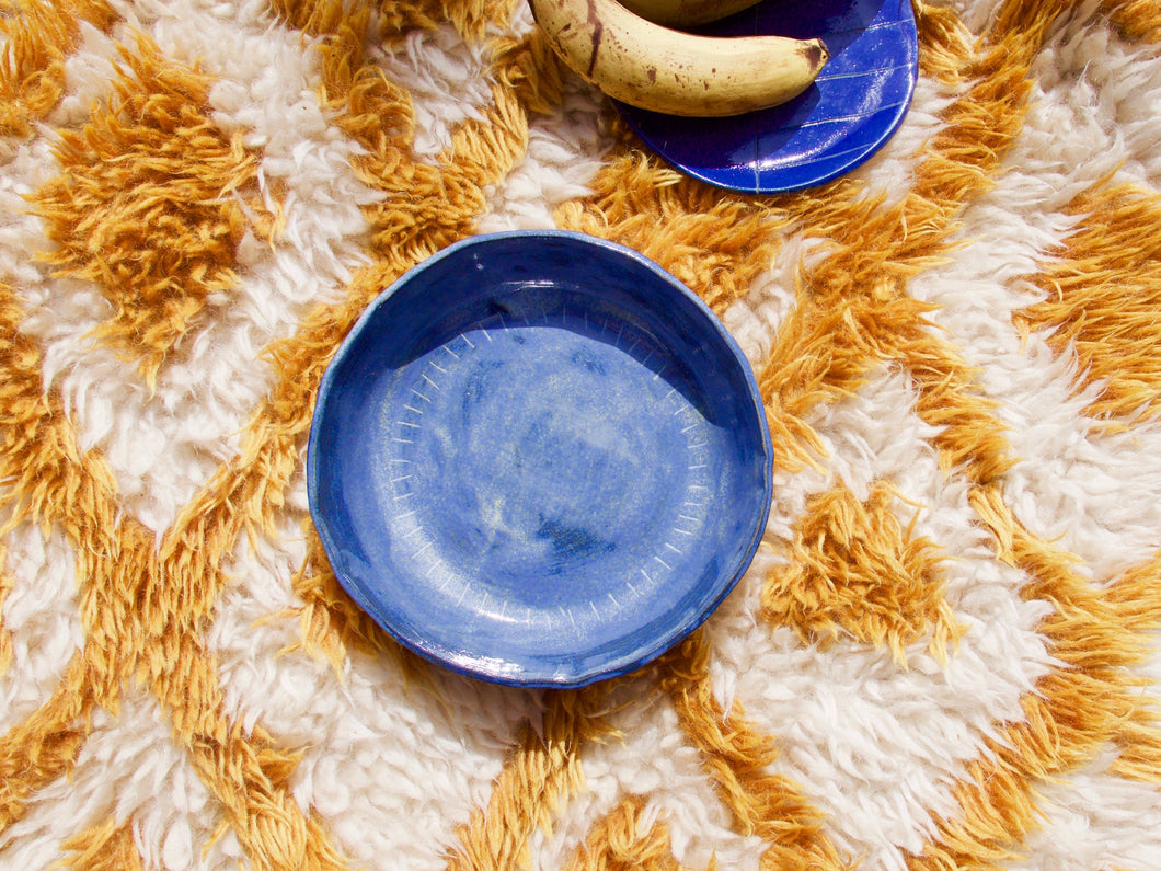 my hungry valentine-studio-ceramics-unique-round serving dish-bottom stripes-cloudy blue-top-bananas