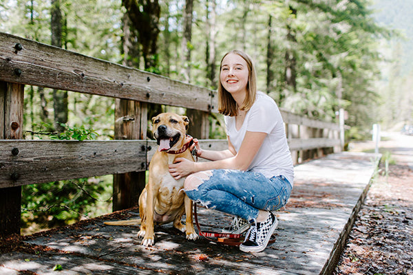 nyah gray of gray and hound poses with neighbor dog sputze in the woods of oregon