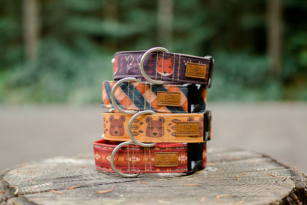 A beautiful stack of hand sewn dog collars featuring woodland animals from Gray and Hound