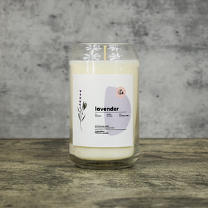 Lavender scent soy wax candle in can shaped glass vessel with tapered top and beautifully minimal label with pastel shapes and a floral drawing from our Hemleva Collaboration
