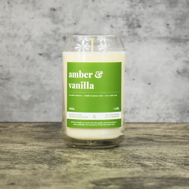 Amber & Vanilla scent soy wax candle in can shaped glass vessel with tapered top and bright green label