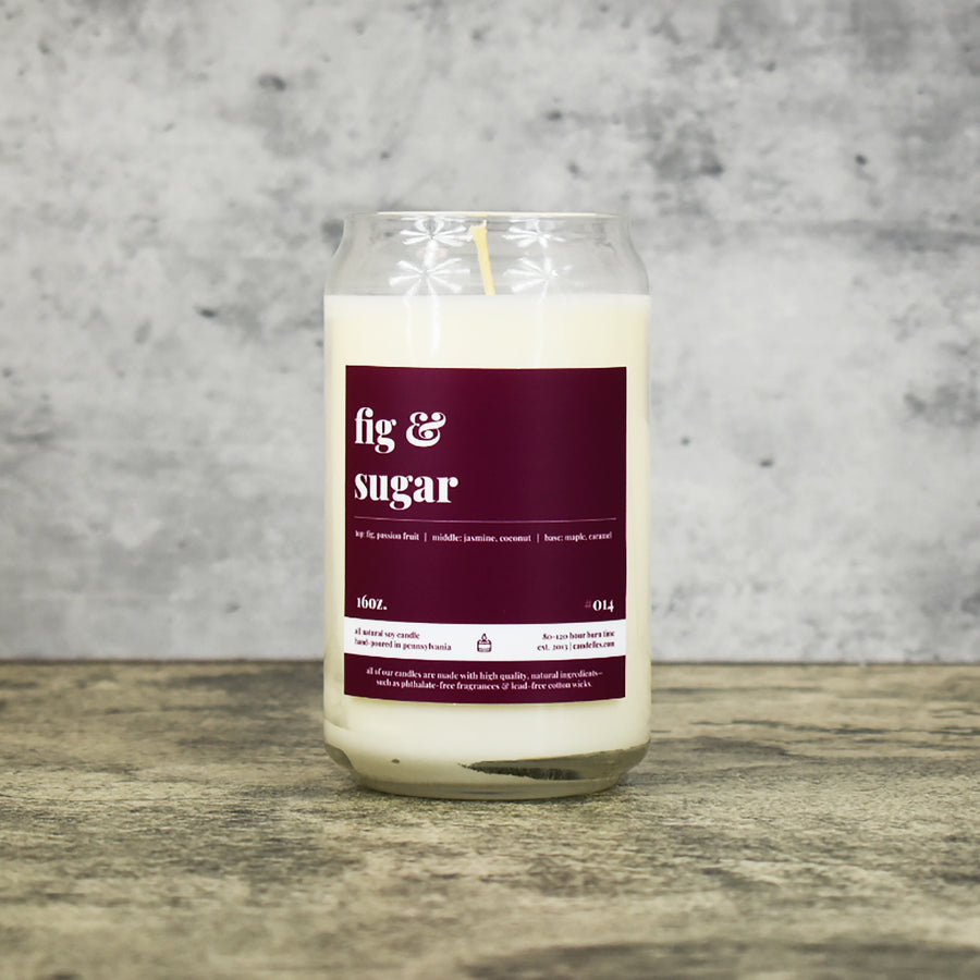 Fig and Sugar scent soy wax candle in can shaped glass vessel with tapered top and deep reddish purple label
