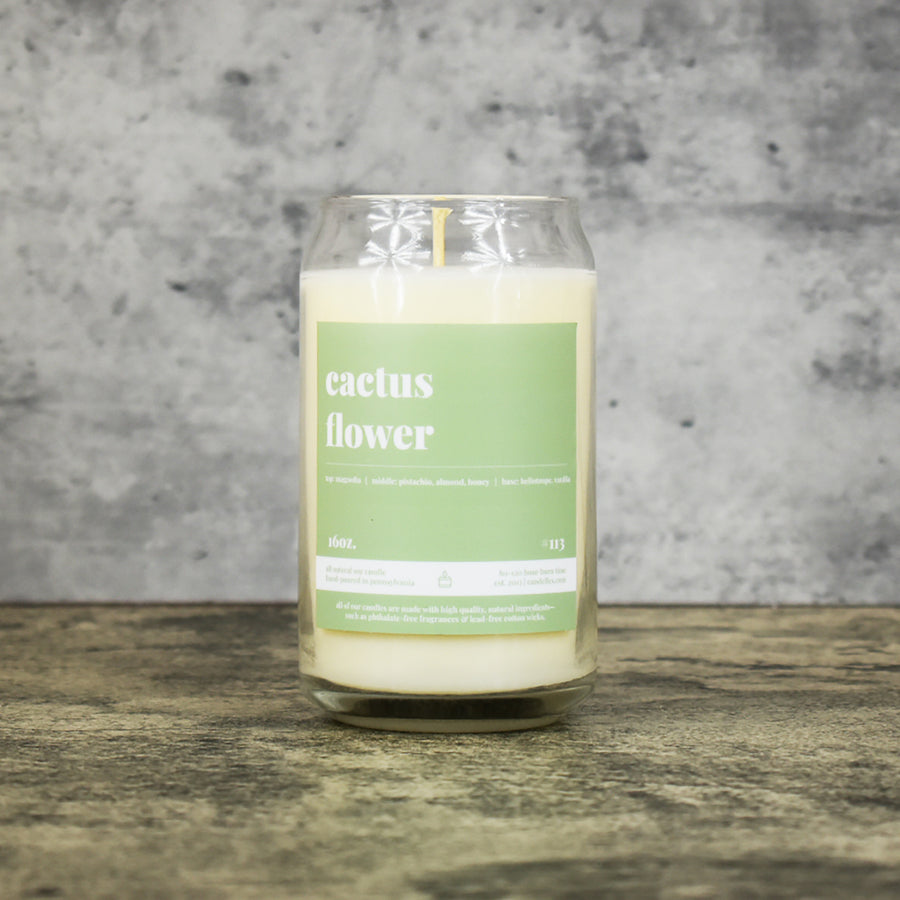 Cactus Flower scent soy wax candle in can shaped glass vessel with tapered top and pastel green label