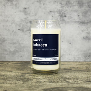 Sweet Tobacco scent soy wax candle in can shaped glass vessel with tapered top and deep charcoal colored label
