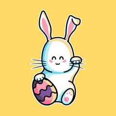 Cute lucky rabbit with its paw up and an Easter egg
