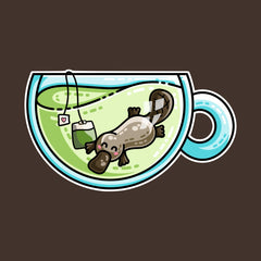 Platypus swimming in a glass teacup of green tea