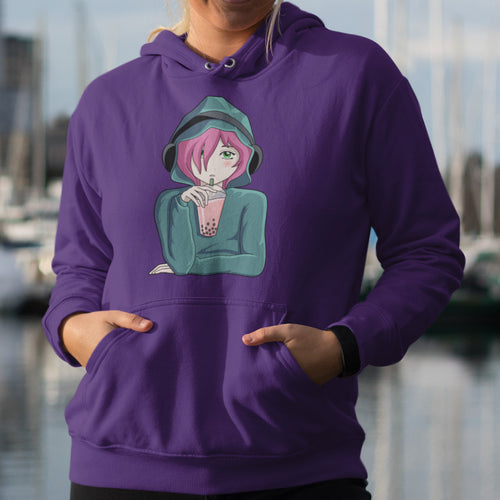Torso of a woman wearing a purple hoodie with her hands in the front pouch and the neck cords tucked in with the design on the chest of an anime girl wearing headphones and drinking boba tea