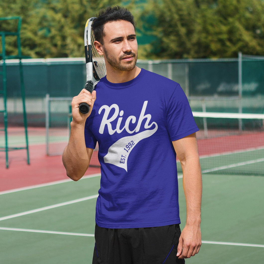 Man playing tennis wearing personalised name and year athletic swish blue crewneck t-shirt
