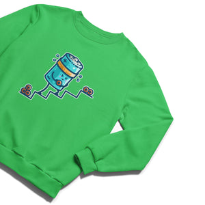 A green unisex crewneck sweatshirt laid flat with a design on its chest of a kawaii cute blue cylindrical battery wearing an orange sweatband, with a facial expression of effort, moving positive charge up steps.