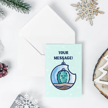 Load image into Gallery viewer, An open white envelope beneath a pale turquoise greeting card with a design of a kawaii cute happy green cactus succulent planted in a transparent hanging bauble terrarium with the words your message above.