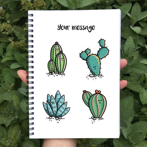 Closed notebook showing white front cover with personalisation and four cute cactus plants